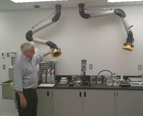 A lab table with spot dust extractors