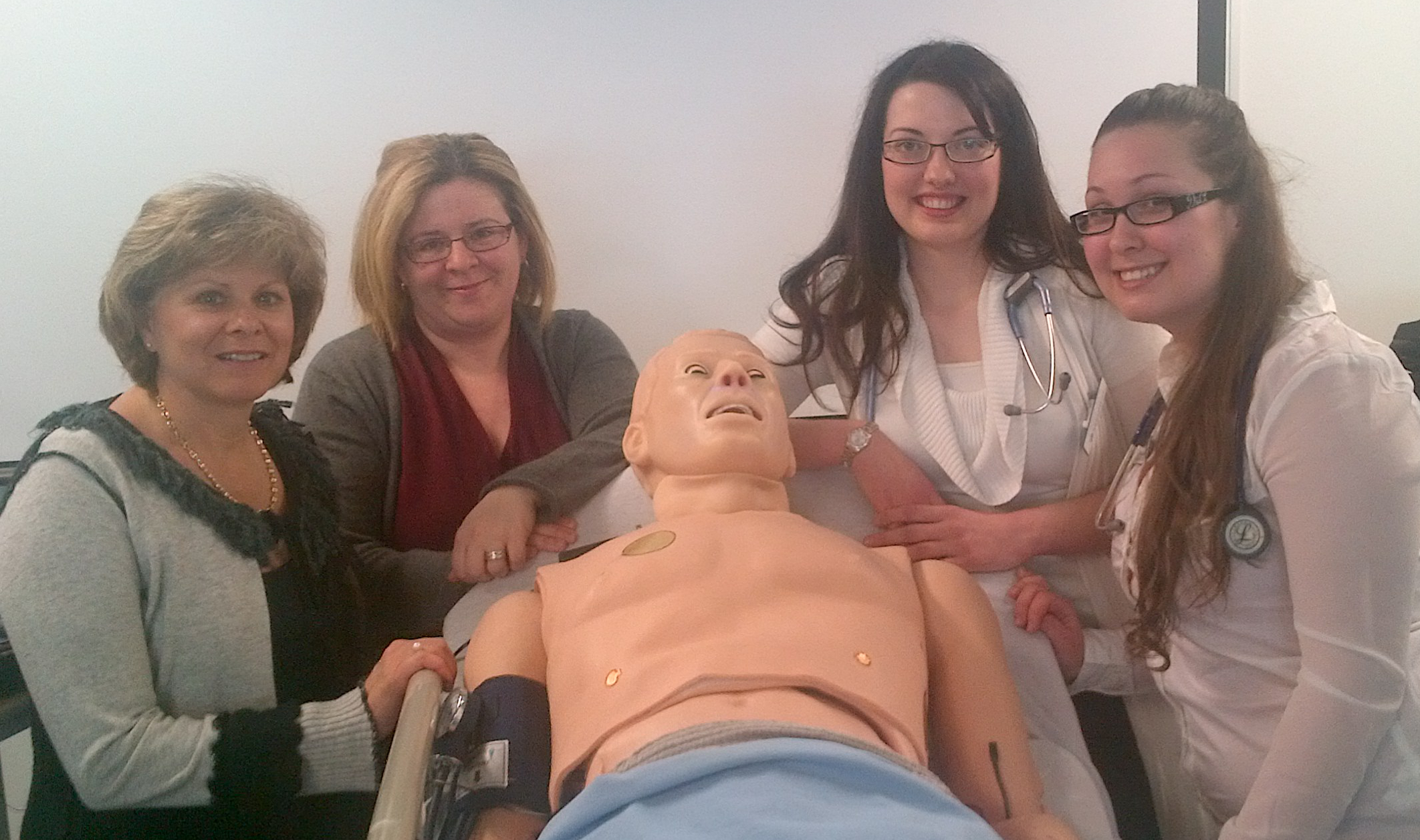 Gloria and Lyne with students during a lab simulating a pulmonary embolism